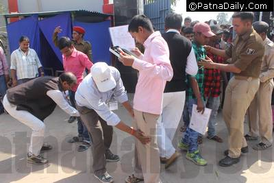 Students being searched for cheats during matric exam in Patna.