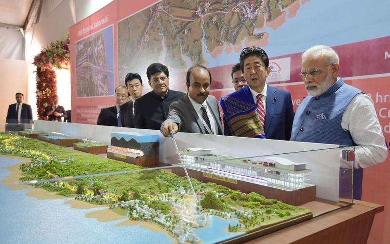 PM Modi with his Japanese counterpart Shinzo Abe discussing bullet train between Ahmedabad and Mumbai.