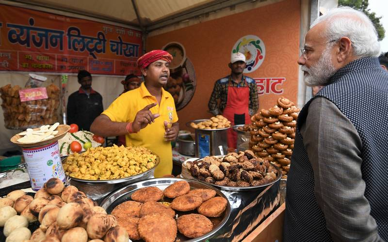 PM Narendra Modi at a litti-chokha stand at a Haat in Delhi.