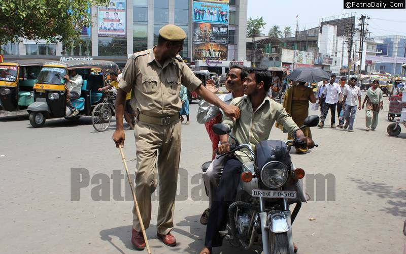 Police in Patna cracking down on bikers without helmets.
